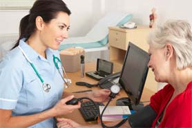 Nurse Taking Patients Blood Pressure